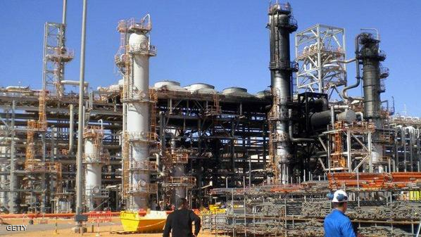This picture taken on January 31, 2013 shows workers outside a desert gas plant after it opened for the press the first time after dozens of foreigners were killed during a four-day standoff that ended in a bloody showdown with Algerian commandos in In Amenas. An Algerian gas facility attacked by Islamists on January 16 is set to reopen within a month, but foreign workers will not return for another three, a plant official said on January 31. Algeria has said 38 workers, out of which 37 were foreign, and 29 kidnappers died in the hostage taking.    AFP PHOTO / JIJI PRESS    JAPAN OUT        (Photo credit should read JIJI PRESS/AFP/Getty Images)