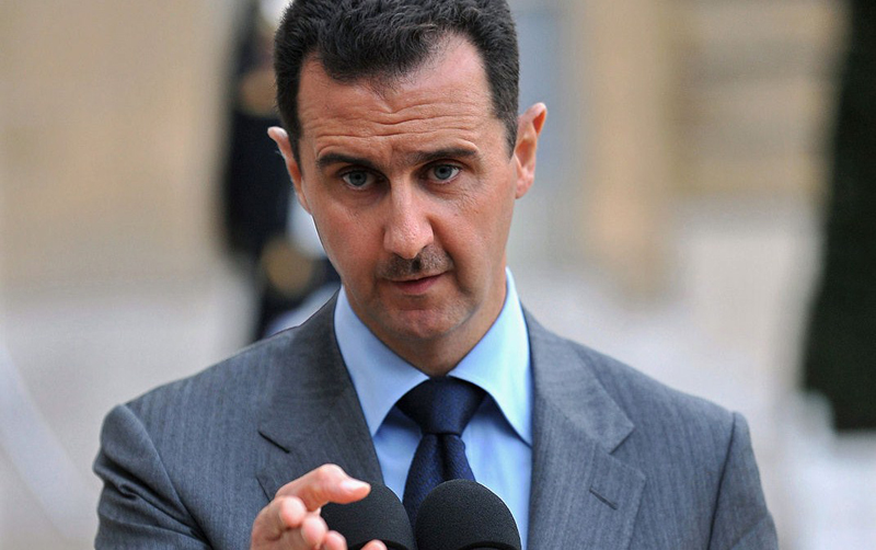 Syrian President Bashar al-Assad speaks to journalists after his meeting with French President Nicolas Sarkozy at the Elysee Palace, in Paris, November 13, 2008. The visiting leader  said that US President Barack Obama should come up with a firm plan of action to renew peace talks between Syria and Israel.  UPI/Eco Clement