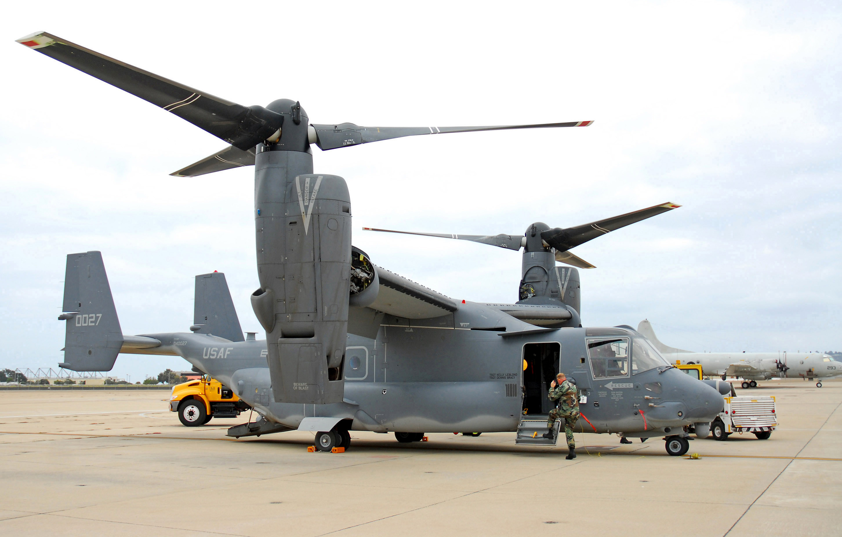 Airmen prepare a CV-22 Osprey Sept. 22 for an exhibition and training exercise with Navy Seals at Naval Air Base North Island, San Diego, Calif. (U.S. Navy photo/Mass Communication Specialist Seaman Daniel A. Barker)